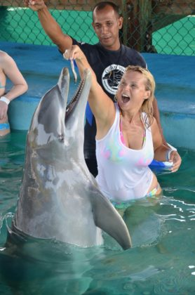 Dolphin plays with woman