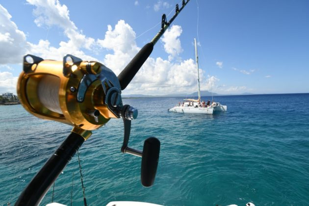 Fishing reel shines under the sun of Puerto Plata, Dominican Republic