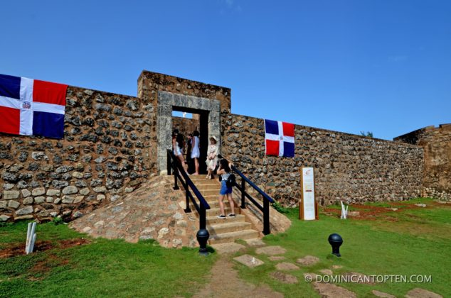 Dominican flags flank the entrance