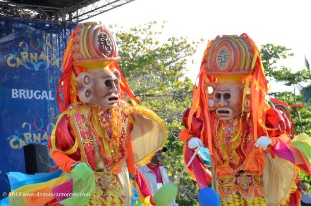 masked dancers performing