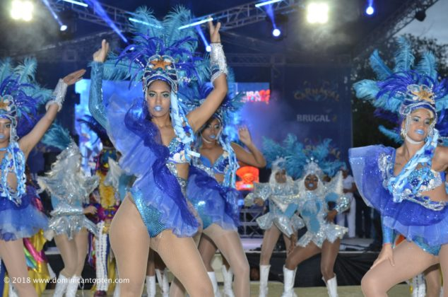 Dancers in blue with feathers