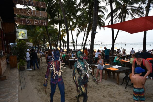 teens with native body paint smile in Cabarete