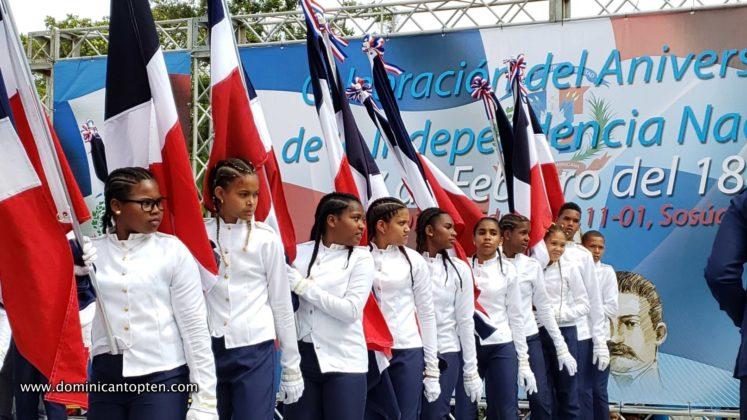 girls holding the DR flag