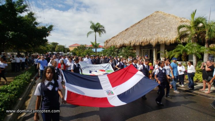 students parade with large dr flag