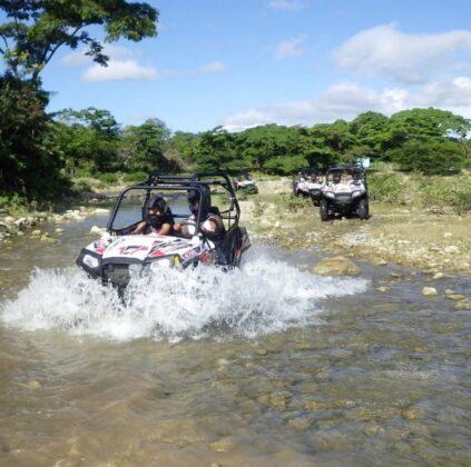 ATV crossing the river