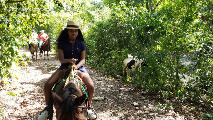 Girl rides a horse in Puerto Plata