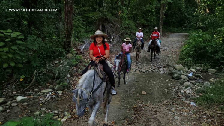 local tourists riding horses in Puerto Plata